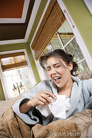 Young Sick Woman Sneezing