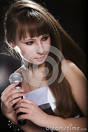 Young singer girl at studio