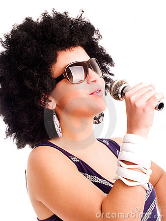 Young singer holding microphone over white