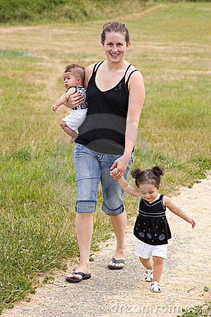 Young single mother family walking