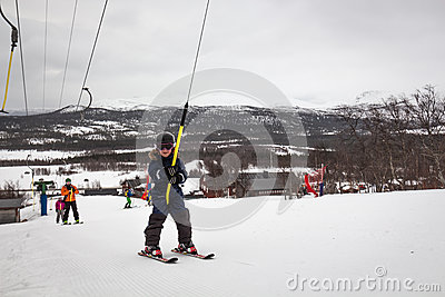 Young skiier in the ski lift Editorial Stock Photo