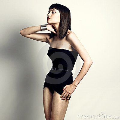Young slender woman in fashionable swimsuit