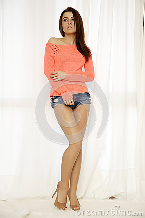 Free Young Slim Sexy Woman In Orange Sweater Against The Window Royalty Free Stock Image - 29879046