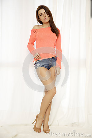Free Young Slim Sexy Woman In Orange Sweater Against The Window Royalty Free Stock Photos - 31584398