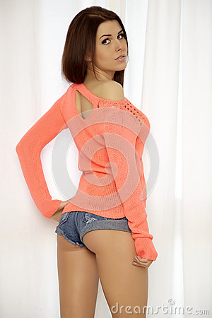 Free Young Slim Sexy Woman In Orange Sweater Against The Window Royalty Free Stock Image - 32831396