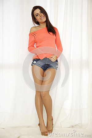 Free Young Slim Sexy Woman In Orange Sweater Against The Window Royalty Free Stock Photography - 32831397