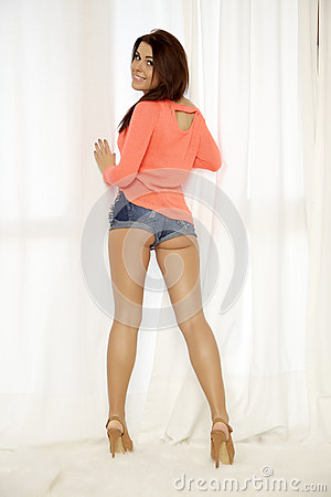 Free Young Slim Sexy Woman In Orange Sweater Against The Window Royalty Free Stock Image - 32831416