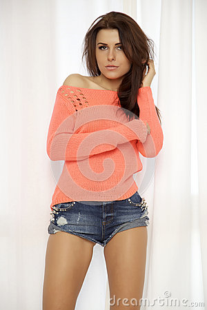 Free Young Slim Sexy Woman In Orange Sweater Against The Window Royalty Free Stock Images - 32831429