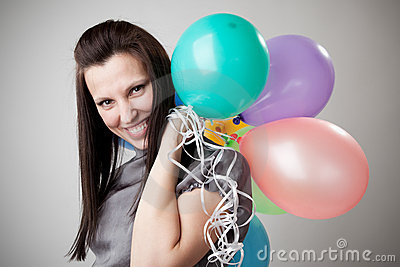 Young slim woman with balloons.
