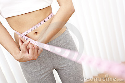 Young Slim Woman Measuring Waist With Tape Measure