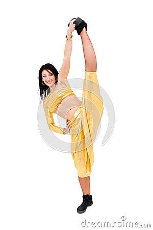 Young smiling acrobat makes splits
