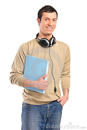 A young smiling boy with headphones holding a book