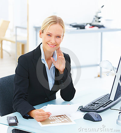 Young smiling business woman sitting
