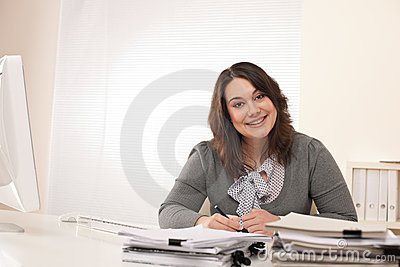 Young smiling business woman working at office