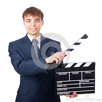 Young smiling businessman with clapperboard