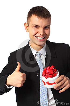 Young smiling businessman with gift  box