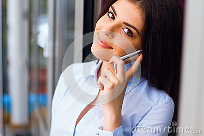 Young smiling businesswoman on phone