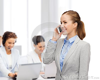 Young smiling businesswoman with smartphone