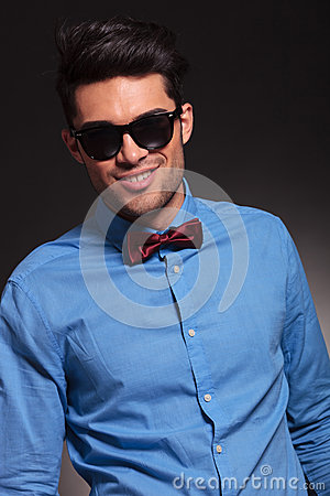 Young smiling fashion man looking to the camera