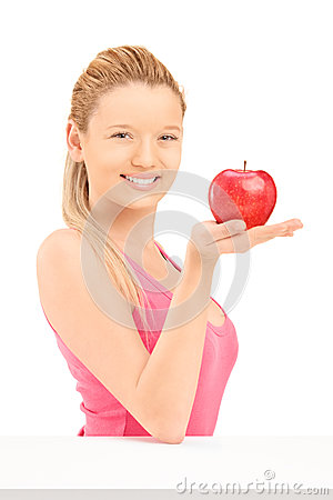 Young smiling female holding a red apple