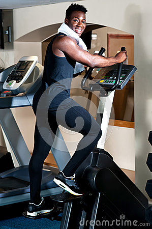 Young smiling fit african male burning calories