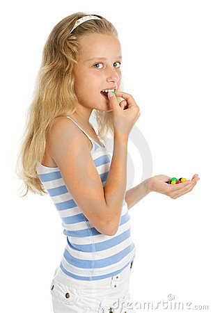 Young smiling girl with chocolate candy