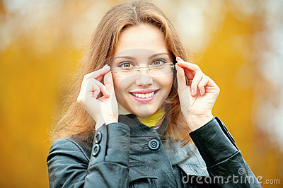 Young smiling girl in glasses
