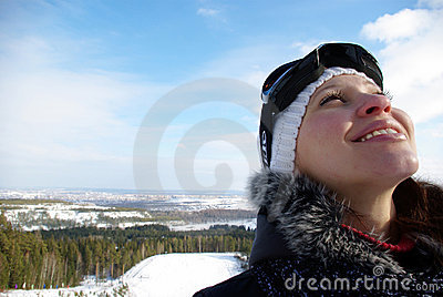 Young smiling girl on ski resort.