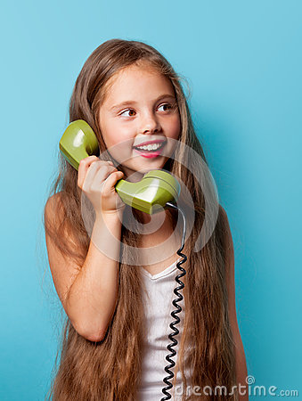 Free Young Smiling Girl With Green Handset Stock Photos - 57998583