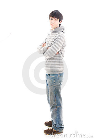 The young smiling guy isolated on a white