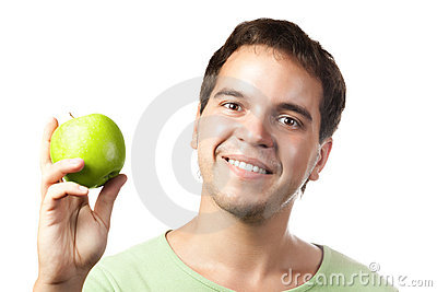 Young smiling man holding green apple isolated