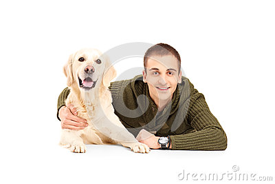 A young smiling man next to his best friend labrador dog