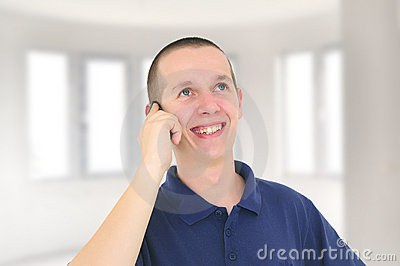 Young smiling man talking on the phone