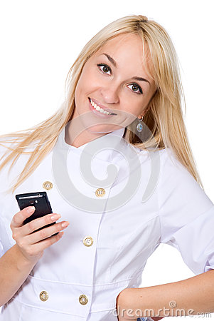 The young smiling nurse with mobile phone