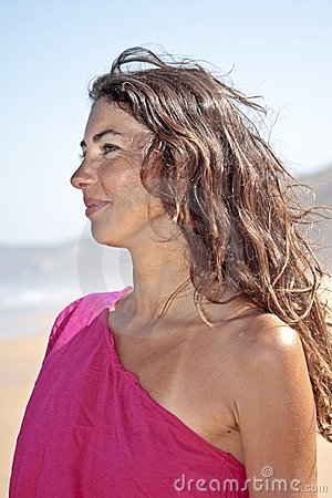Young smiling woman at the beach