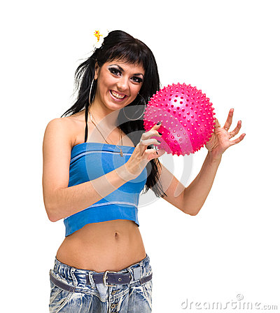 Young smiling woman with fitness ball