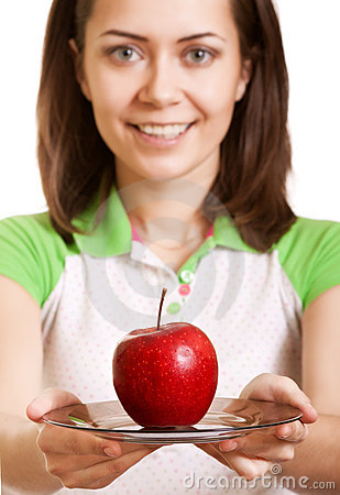 Young smiling woman give red apple on plate