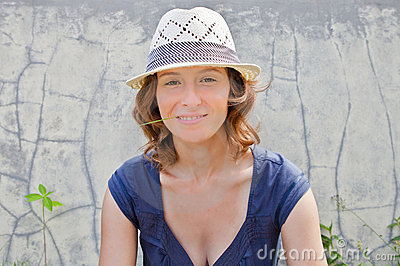 Young smiling woman in hat