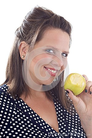 Young smiling woman holding an apple