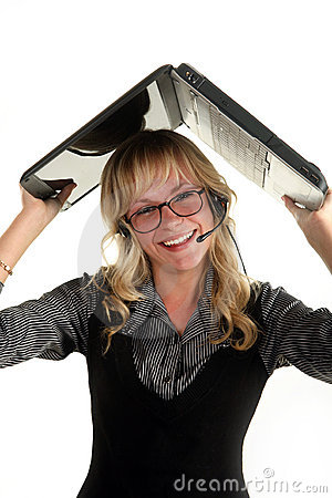Young smiling woman holding laptop over her head