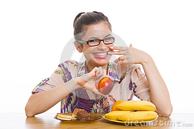 Young smiling woman holding nectarine