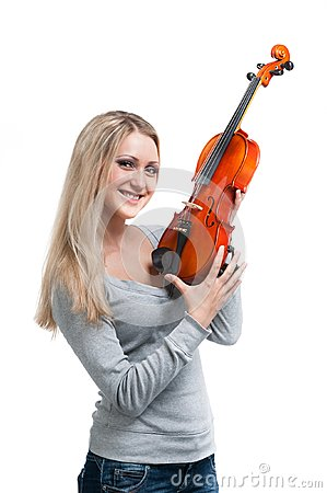 Young smiling woman holding a violin