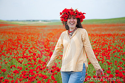 Young smiling woman in poppy field