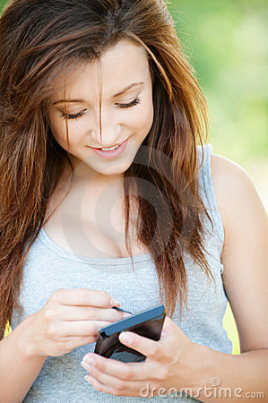 Young smiling woman with smartphone