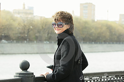 Young smiling woman in sunglasses