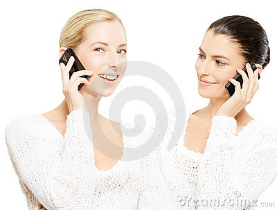 Young smiling women with smartphones