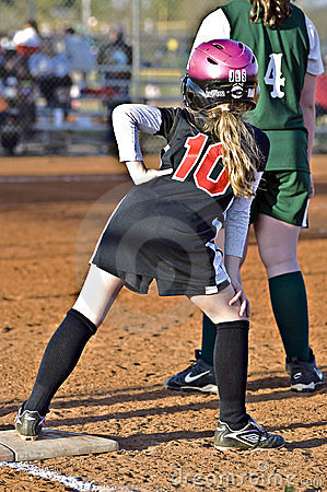 Young Softball Player on Base Editorial Image