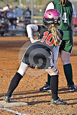 Young Softball Player on Base Editorial Image