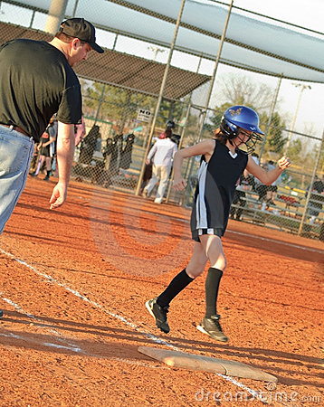 Young Softball Player Running to Base