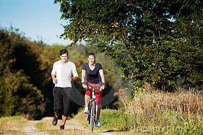 http://thumbs.dreamstime.com/x/young-sport-couple-jogging-cycling-12738645.jpg
